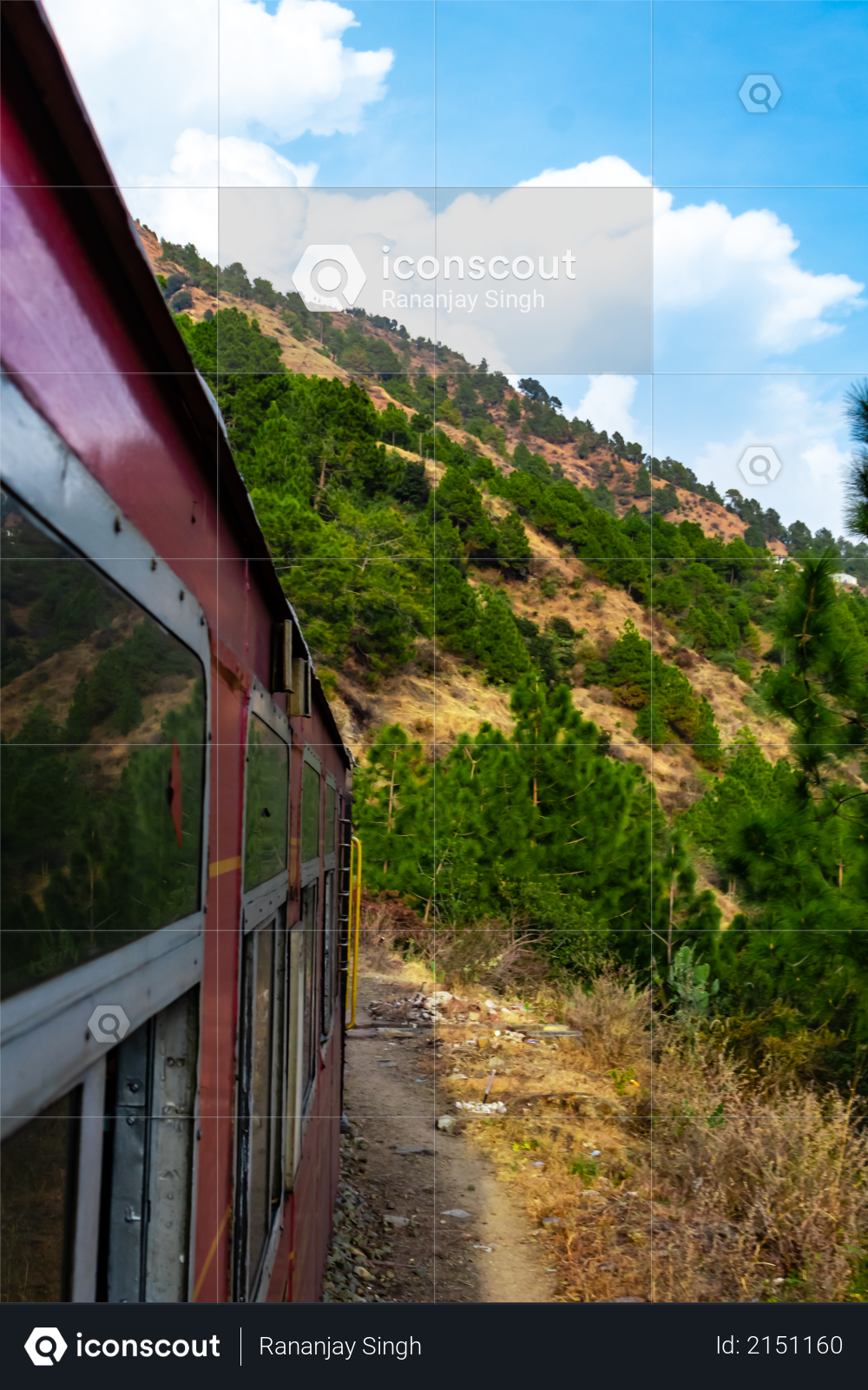 Potrait photography of train and mountain with cloudy blue sky in the background Photo