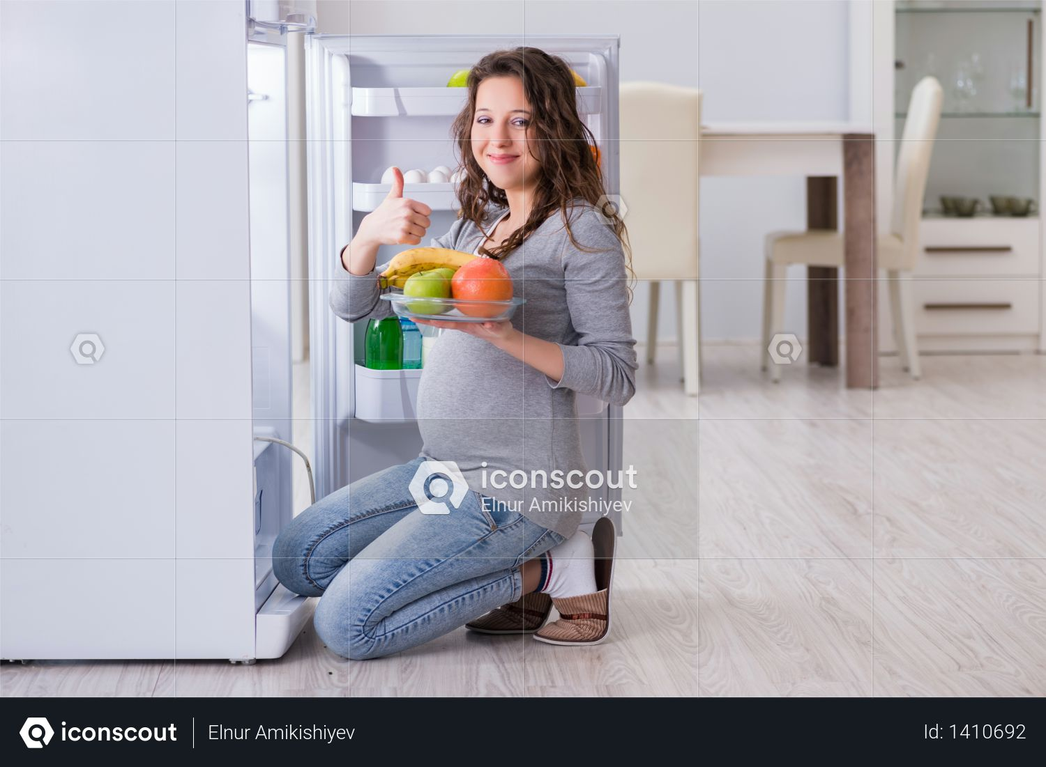Pregnant woman near fridge looking for food and snacks Photo