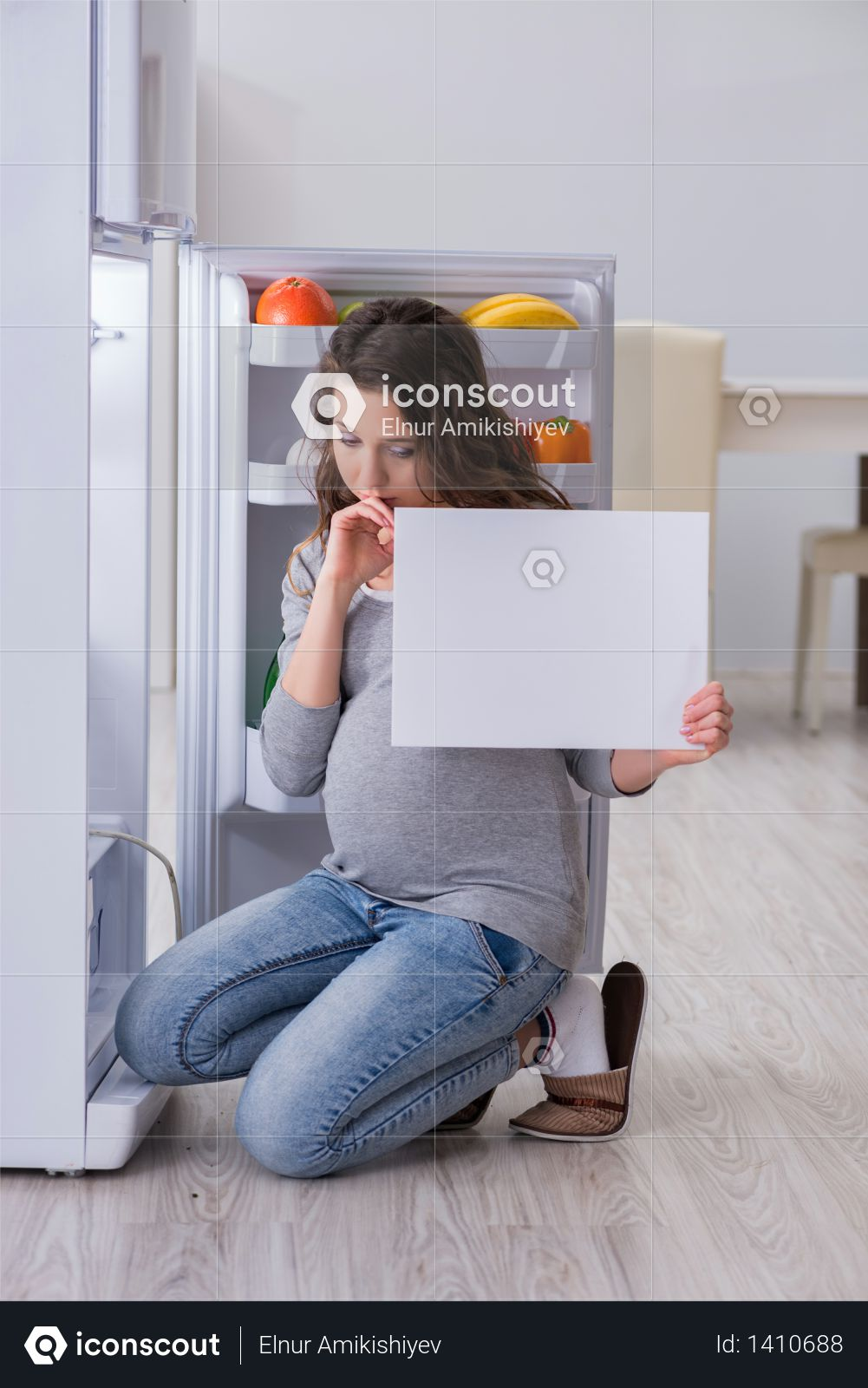 Pregnant woman near fridge with blank message Photo