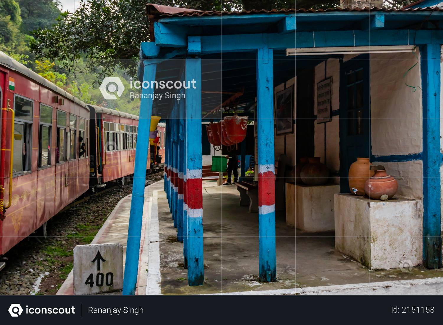 Railway station with a train passing by, travel concept Photo