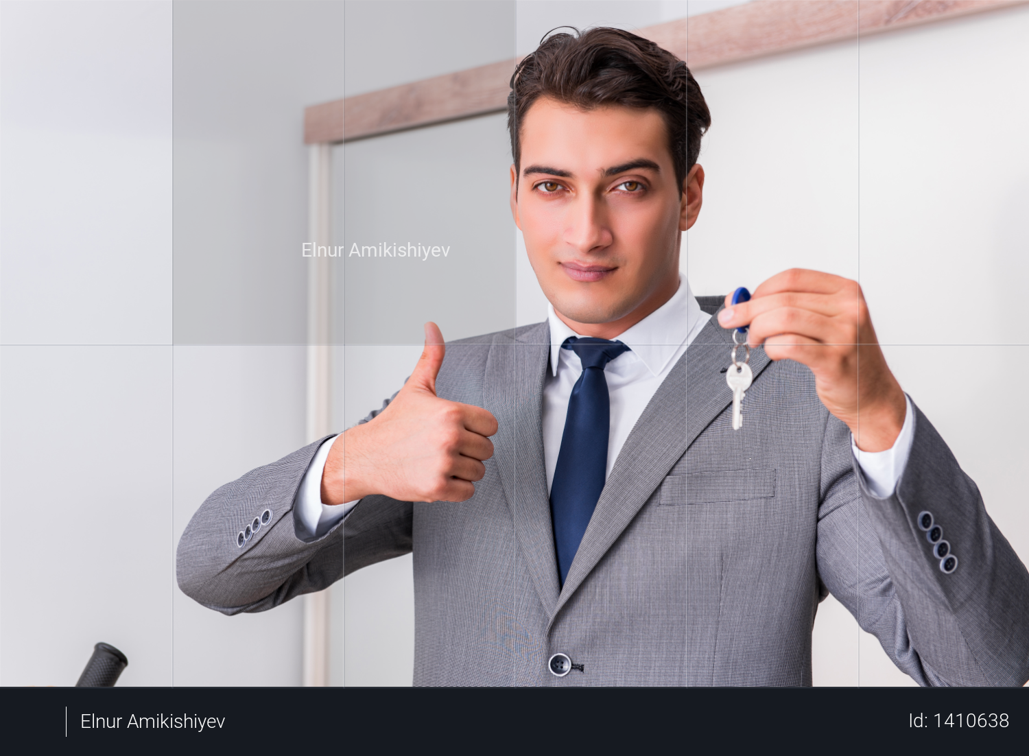 Real estate agent with key from new house Photo