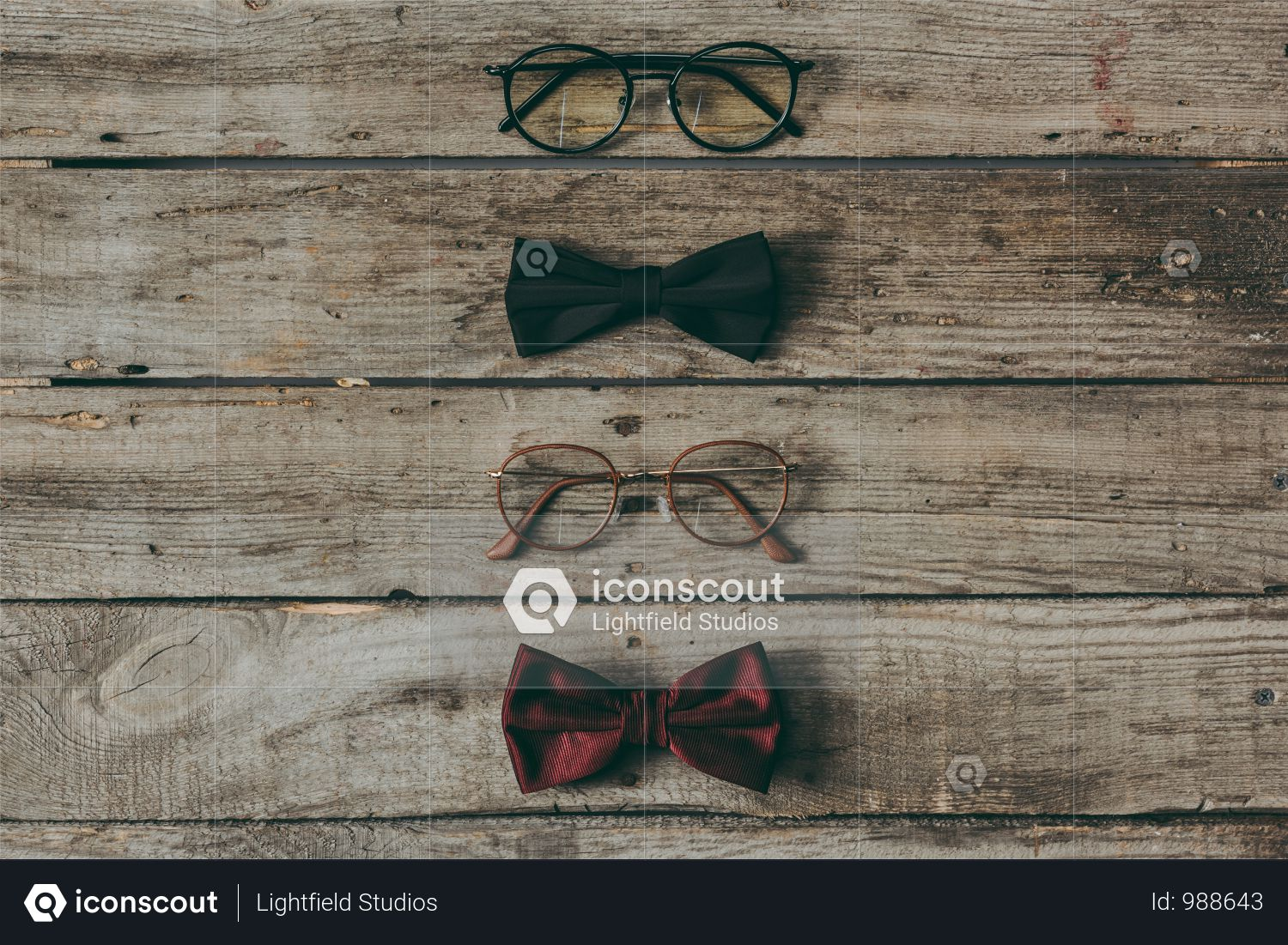 Row Of Stylish Eyeglasses And Bow Ties On Wooden Tabletop Photo