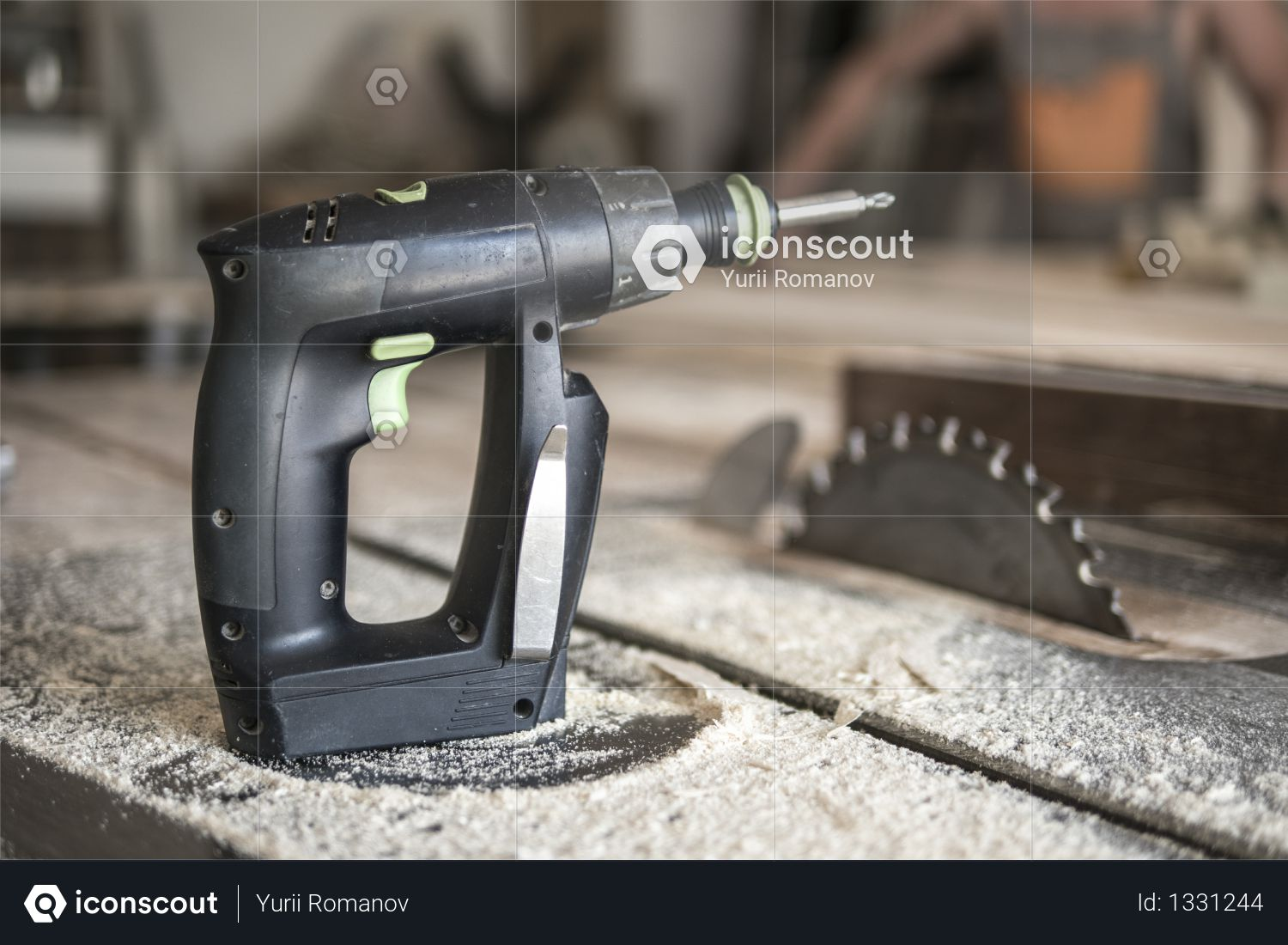 Screwdriver and circular saw in sawdust. joiner's workshop. Photo