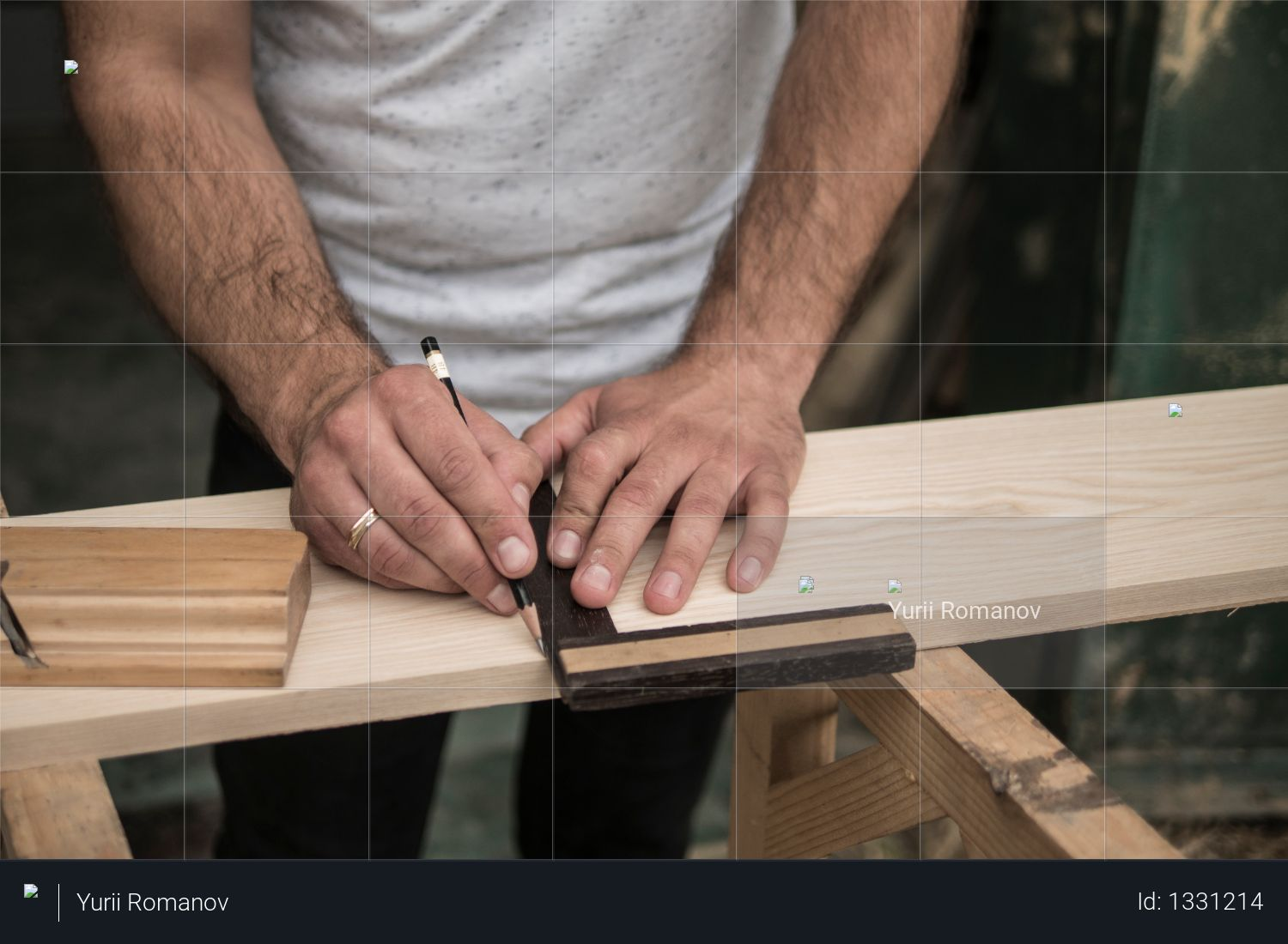 The joiner marks the workpiece with a pencil. joinery. carpenter. woodworker Photo