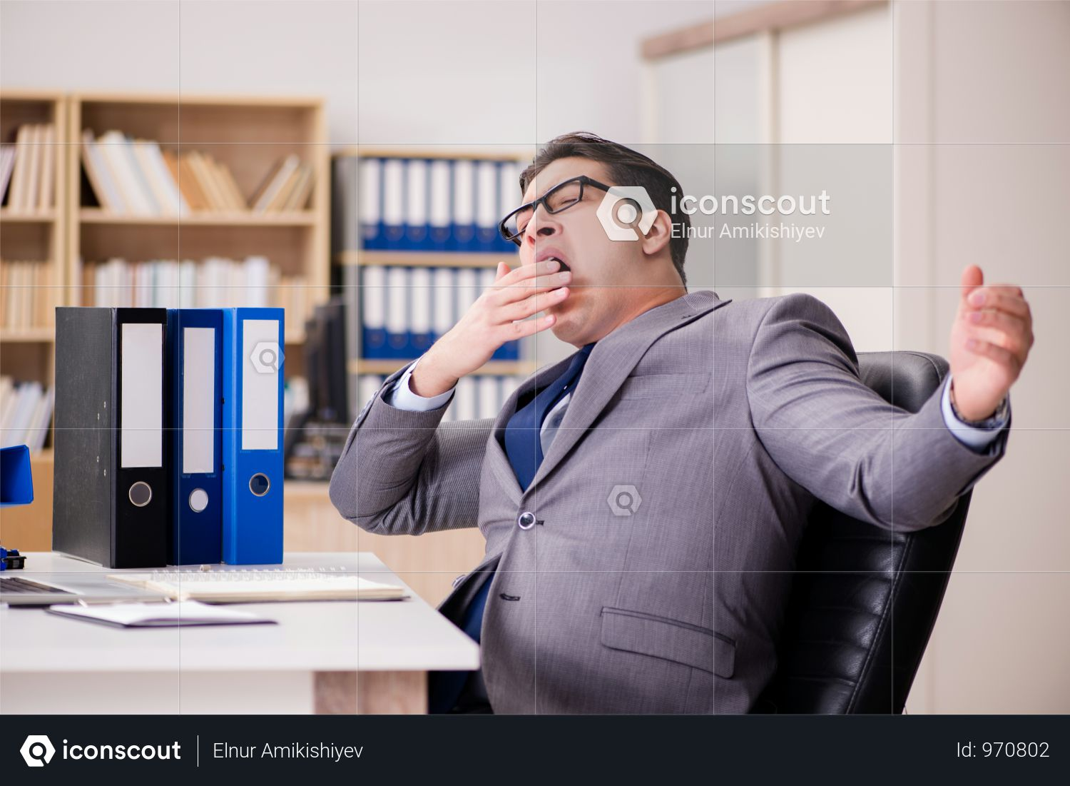 Tired Businessman Working In The Office Photo