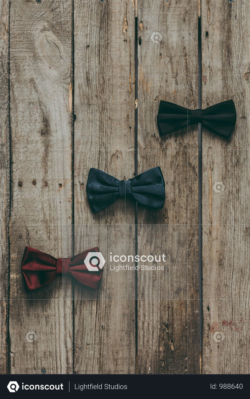 Top View Of Classic Bow Ties On Wooden Tabletop Photo