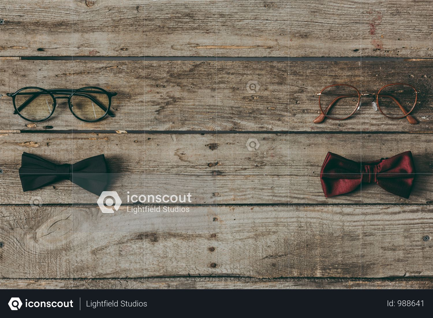 Top View Of Stylish Bow Ties And Eyeglasses On Wooden Tabletop Photo