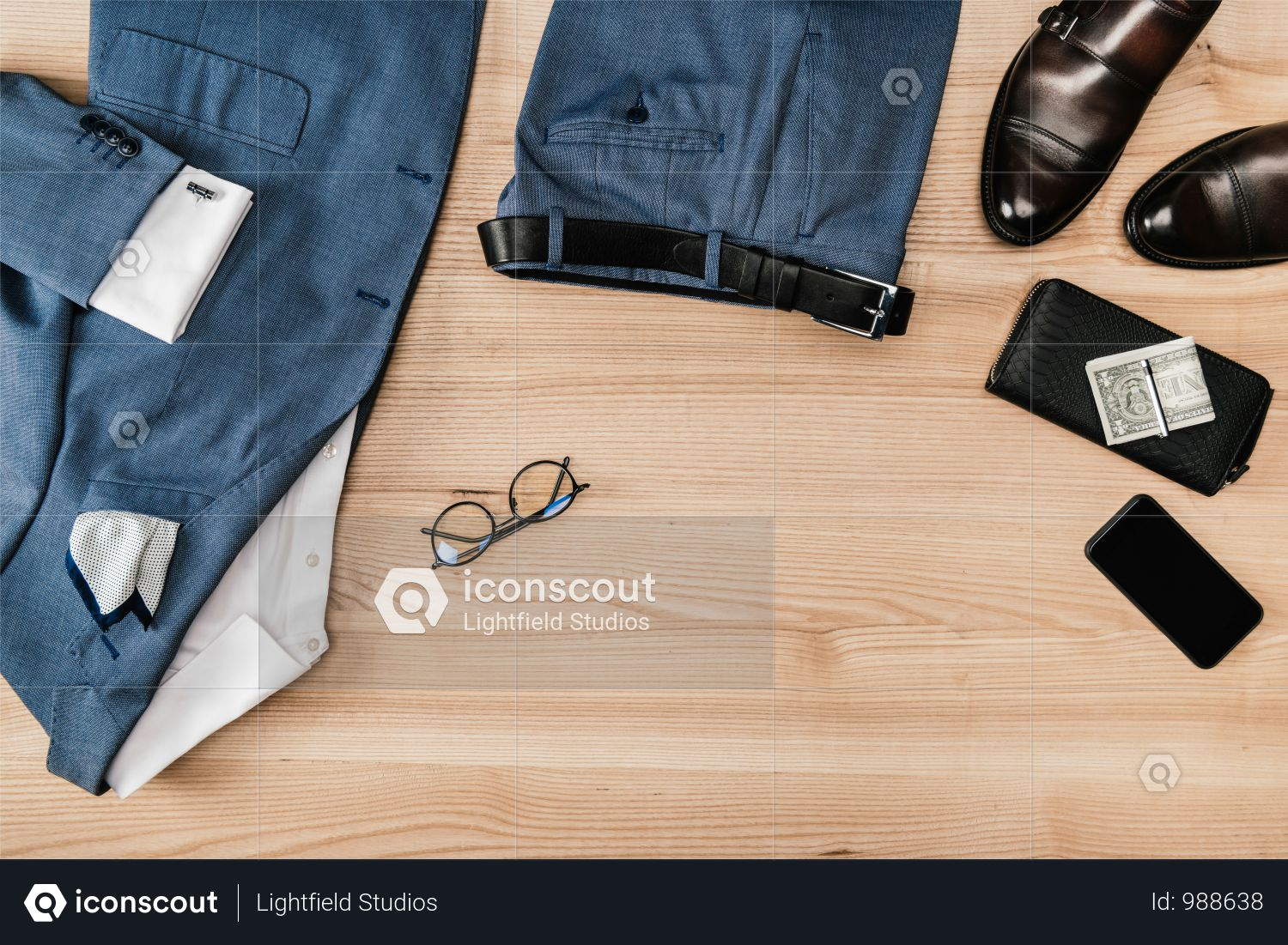 Top View Of Suit And Accessories With Smartphone On Wooden Tabletop Photo