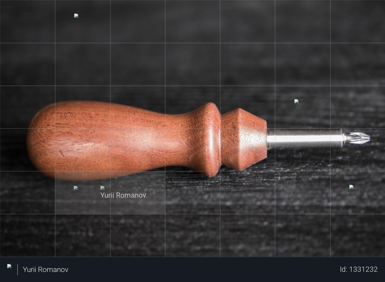 Vintage mahogany screw on a black background Photo