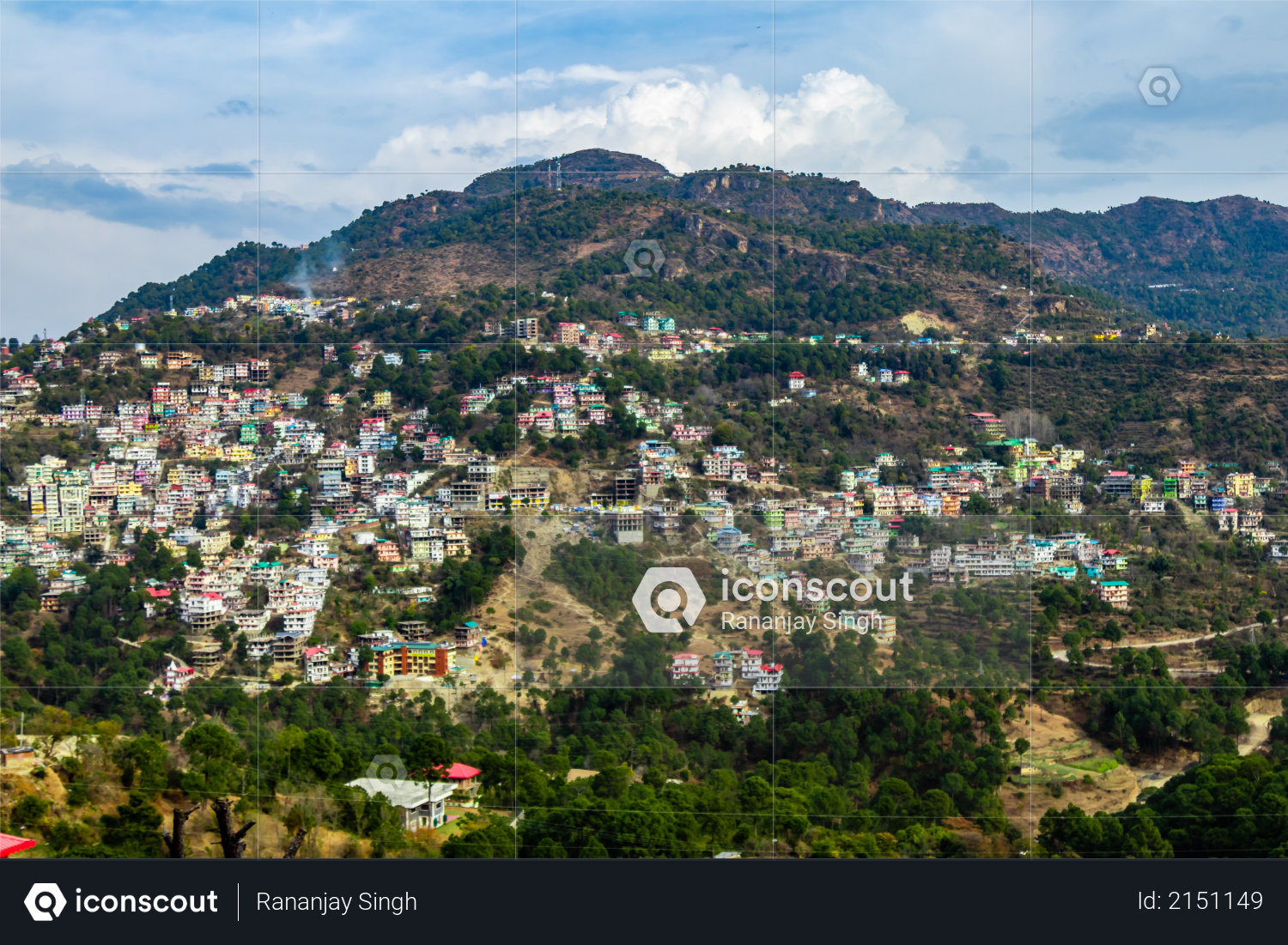 Wide shot of beautiful cityscape on mountains under the cloudy blue sky Photo