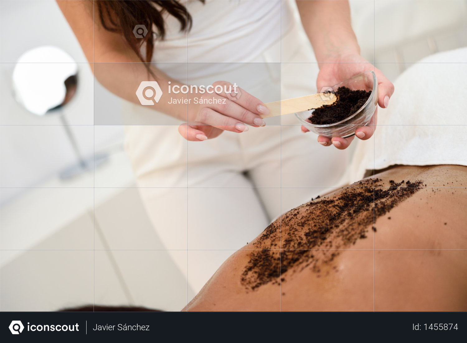 Woman cleans skin of the body with coffee scrub in spa wellness center. Beauty and Aesthetic concepts. Photo