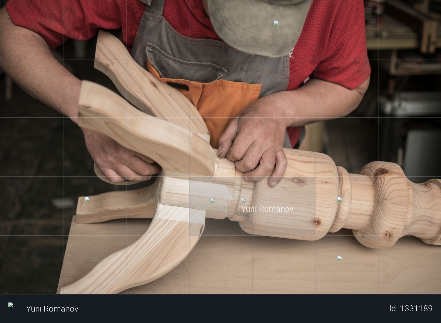 Woodworker, carpenter makes a table with carved legs of pine. woodworking Photo