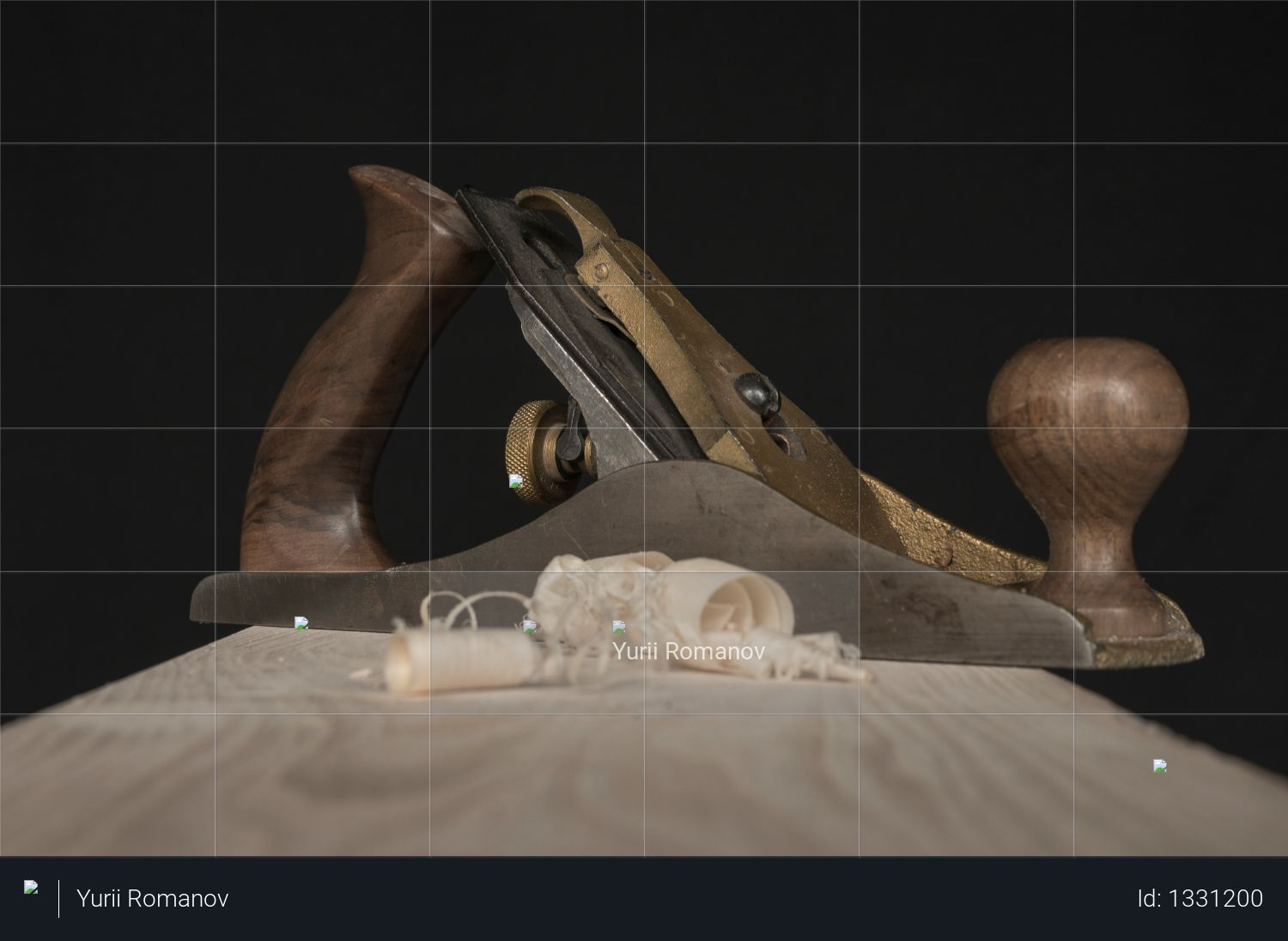 Woodworking hand plane and shavings on a black background Photo