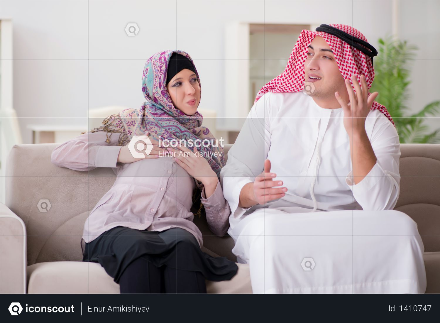Young arab muslim family with pregnant wife expecting baby Photo