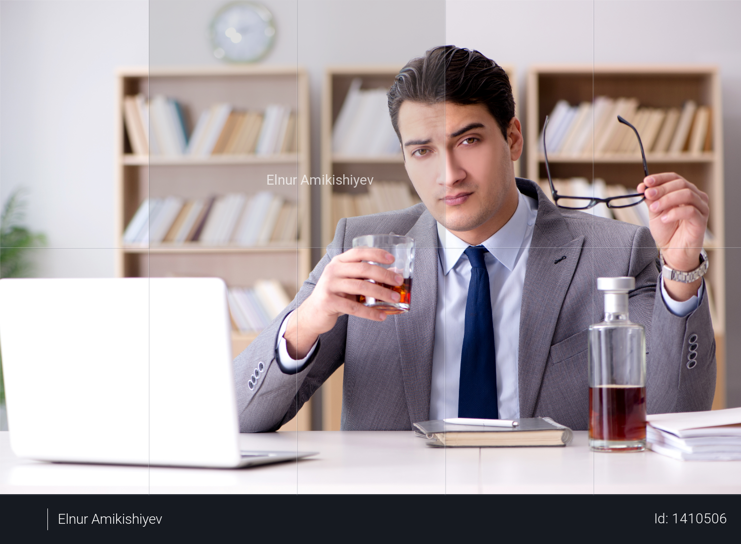 Young businessman drinking from stress Photo