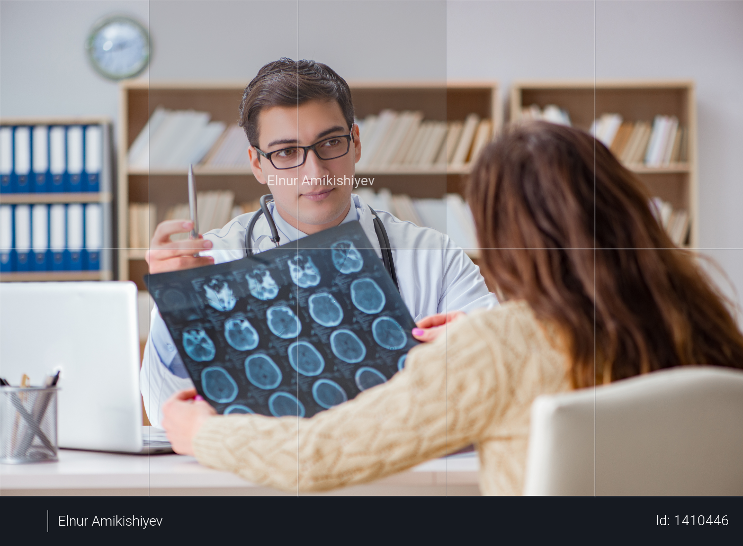 Young doctor looking at computer tomography x-ray image Photo