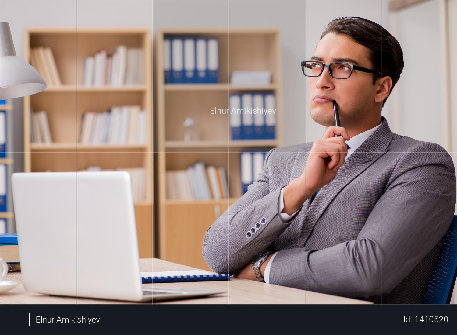 Young handsome businessman working on office Photo