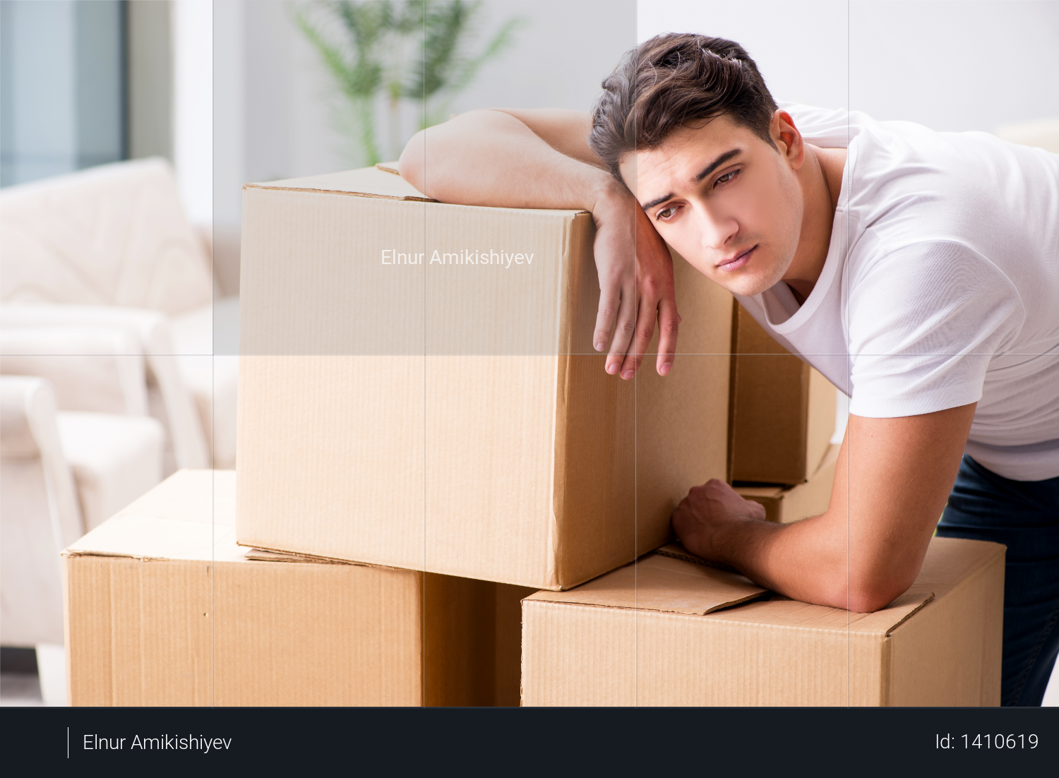 Young man moving boxes at home Photo