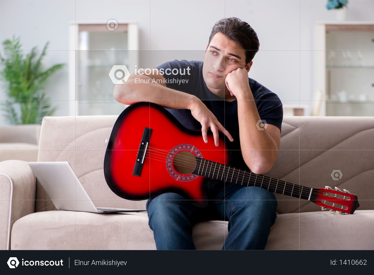 Young man practicing playing guitar at home Photo