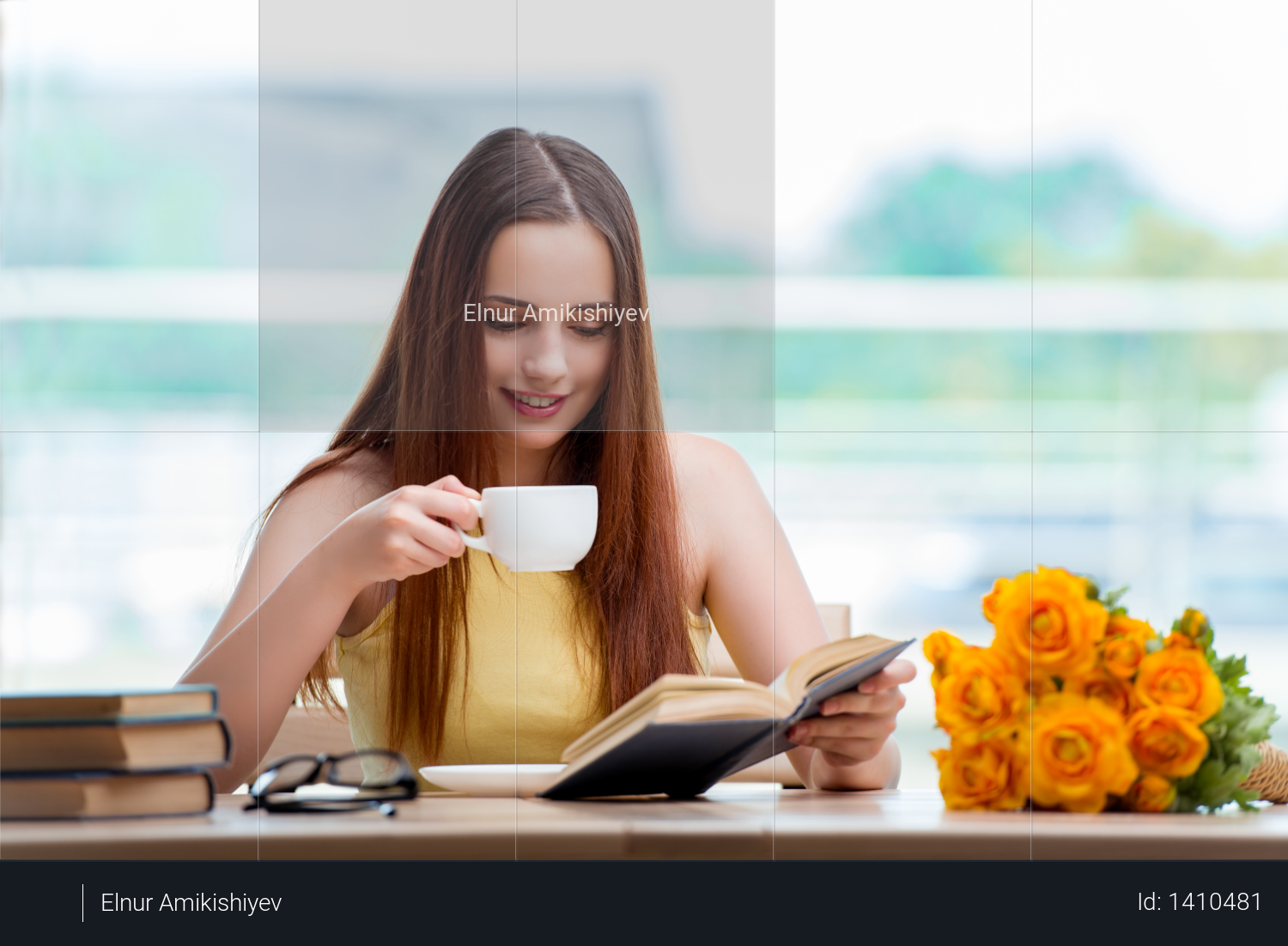 Young student drinking coffee while sudying Photo