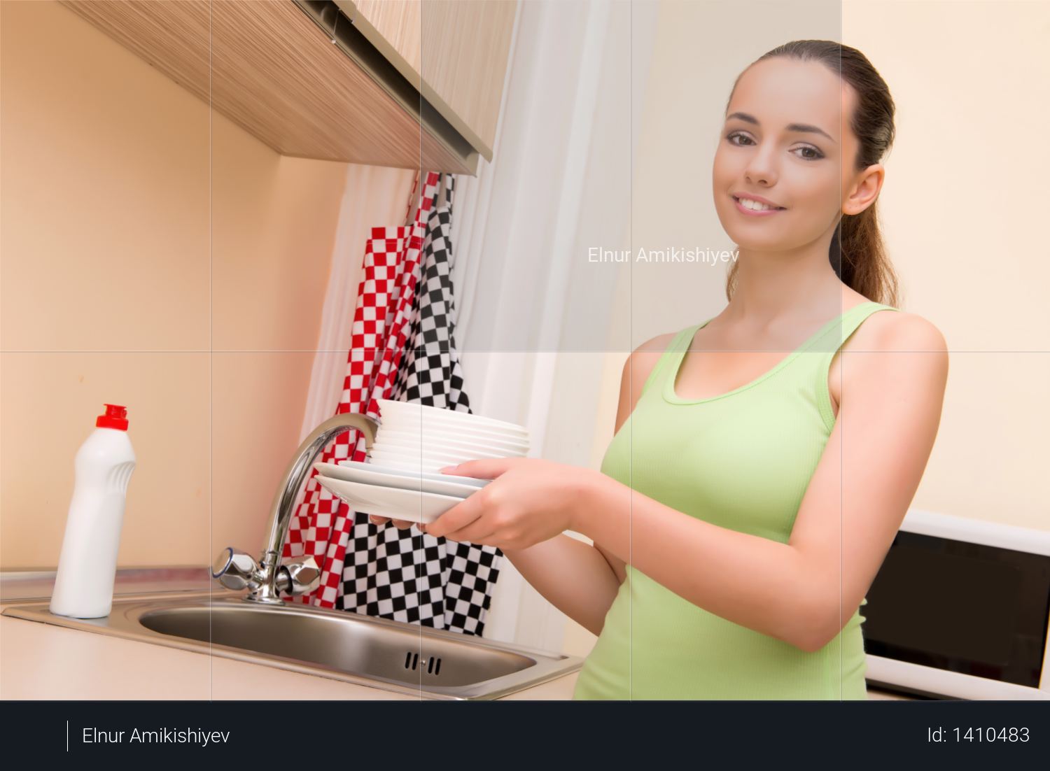 Young wife woman washing dishes in kitchen Photo