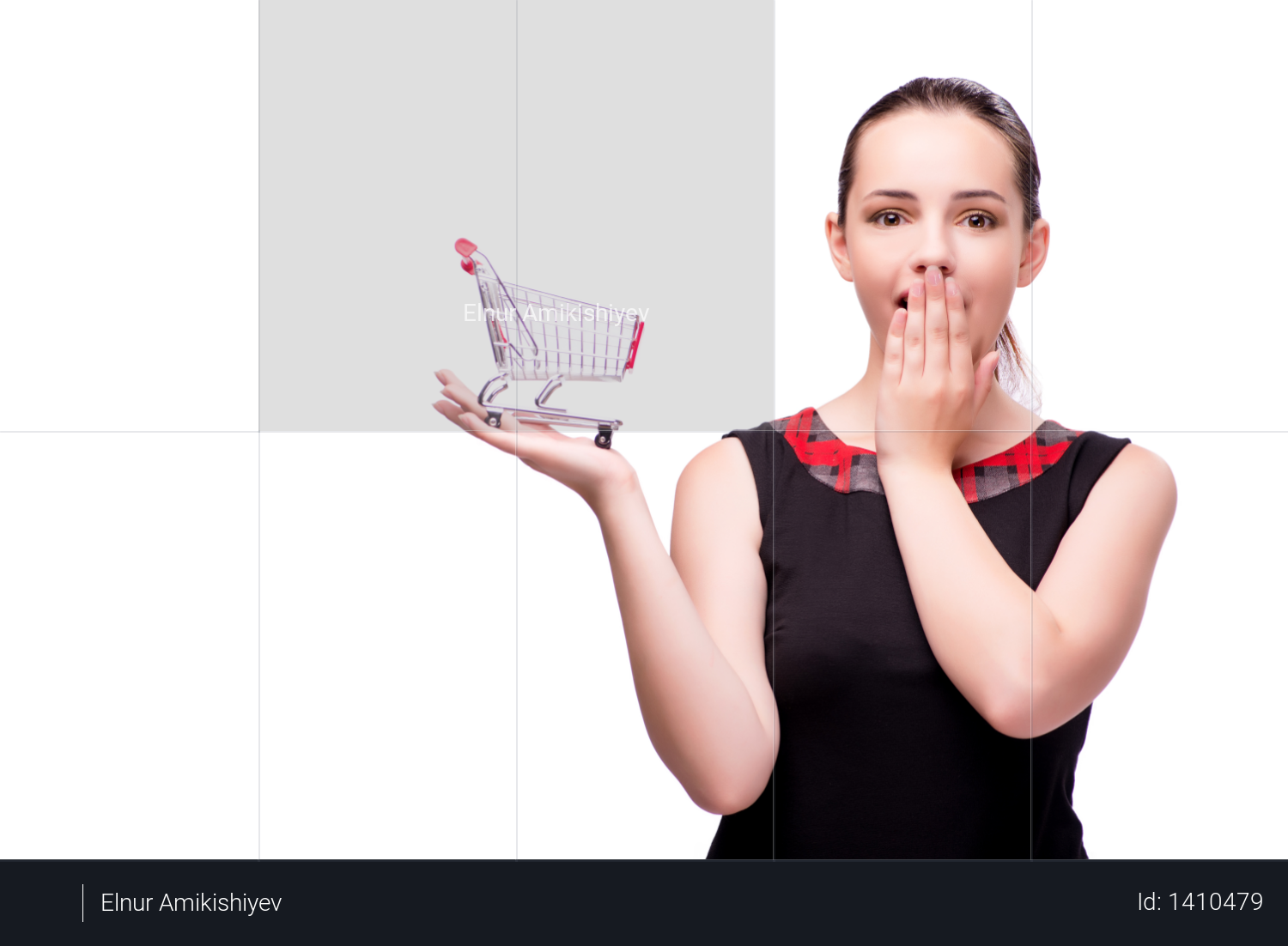 Young woman with shopping cart isolated on white Photo