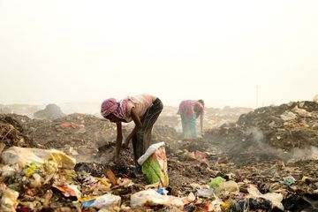 Rag Pickers Search For Recyclable Material In The Garbage Shoot