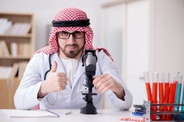 Doctor Consulting Arab Family Stock Images
