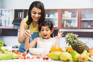 Mother And Daughter In Kitchen Shoot