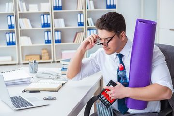 Businessman Doing Sports At His Office Space Stock Images