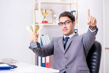 Businessman With Trophy Stock Images