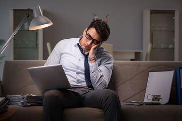 Workaholic Businessman Stock Images