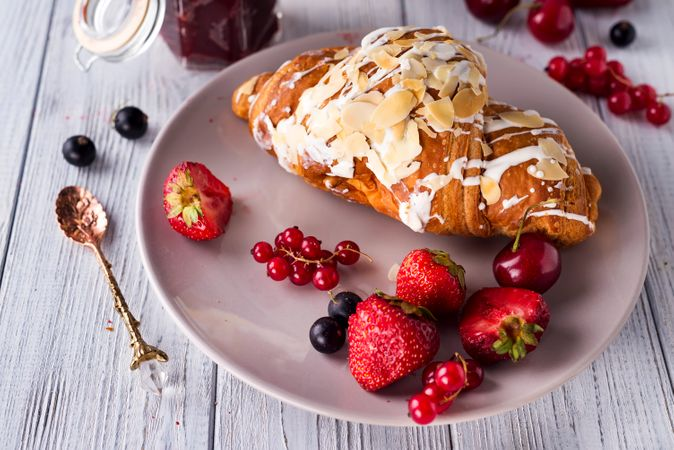 Croissants, Corn Flakes And Berries On Light Gray Background
