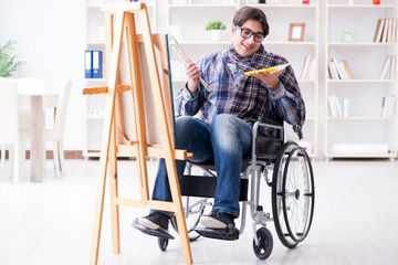 Disabled Artist Painting Picture In Studio Shoot