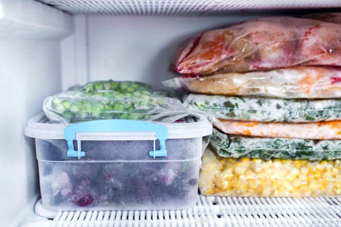 Frozen Berries And Vegetables In Bags In Freezer