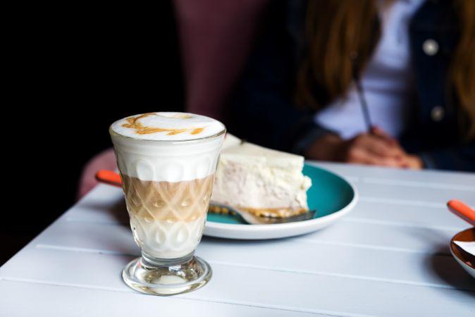 Glass Of Latte Macchiato With Rich Milk Foam In Cafe
