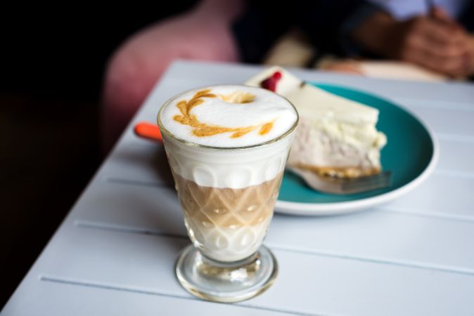 Glass Of Latte Macchiato With Rich Milk Foam In The Cafe Table