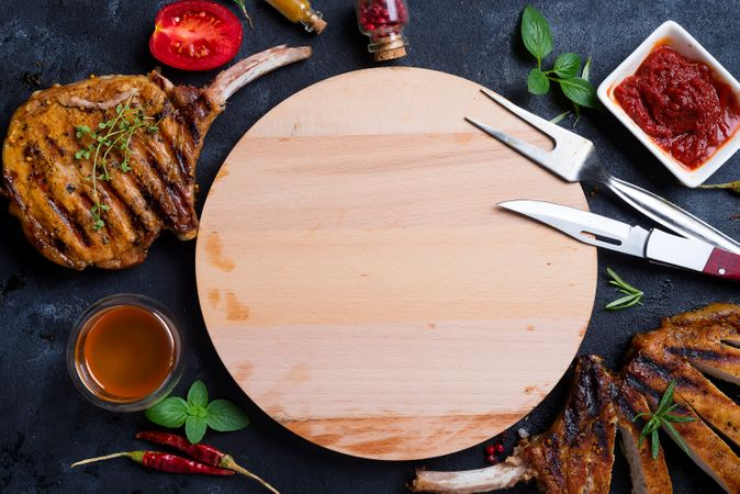 Grilled T-bone Steak On Stone Table With Wooden Board
