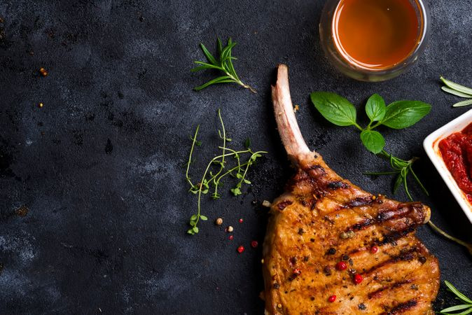 Grilled T-bone Steak With Ketchup On Stone Table