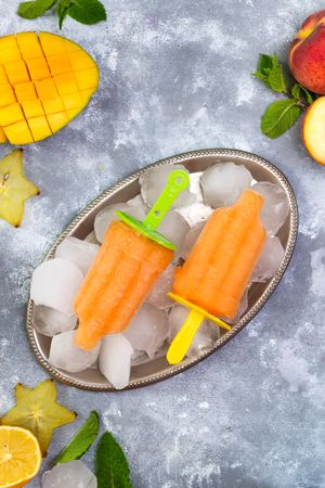 Homemade Yellow Popsicles With Ice And Berries