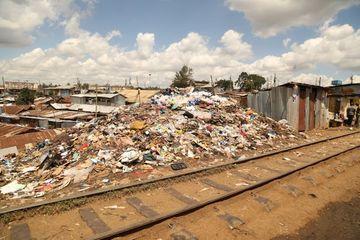 People Walk Near Piles Of Trash Nairobi Kenya Africa Shoot