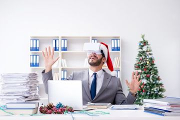 Young Businessman Celebrating Christmas In The Office Shoot