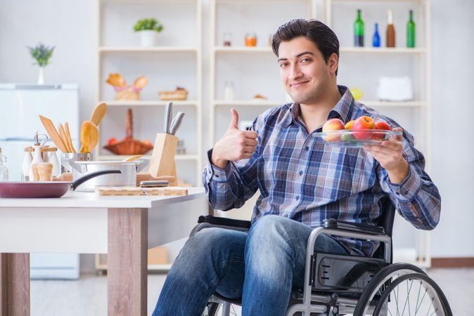Young Disabled Husband Preparing Food Salad