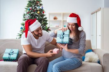 Young Family Expecting Child Baby Celebrating Christmas Shoot