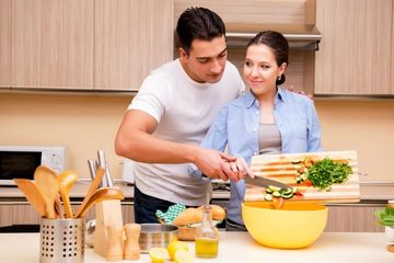 Couple Cooking Food Stock Images