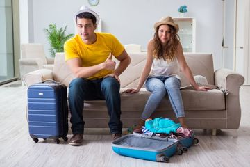 Couple Packing For Vacation Shoot