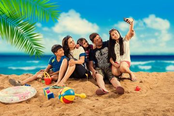 Young Indian Family At Beach Shoot